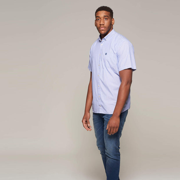 Fortmens model wearing a North 56°4 Sustainable Striped Short Sleeve Shirt in Sky Blue - full body