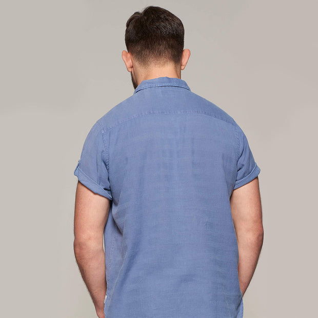Fortmens model wearing Replika soft and light short sleeve shirt in indigo blue - back view
