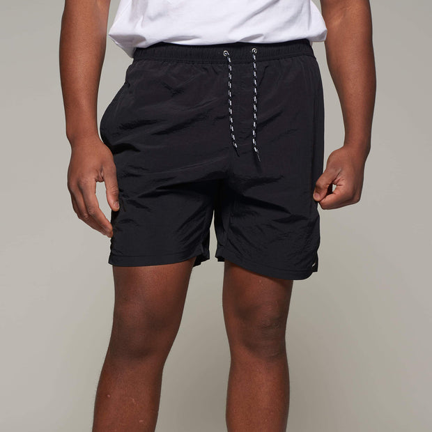 Fortmens model wearing North56 Sport Swim Shorts Black - back view