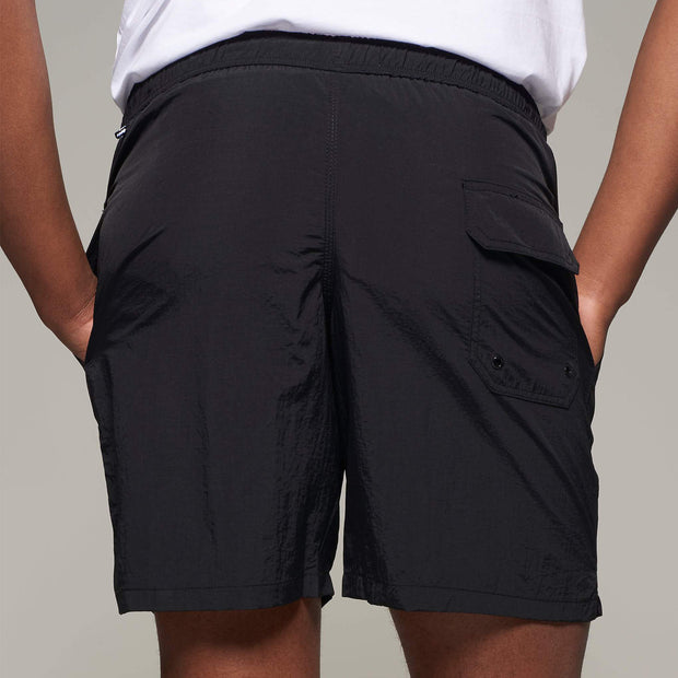 Fortmens model wearing North56 Sport Swim Shorts Black - front view