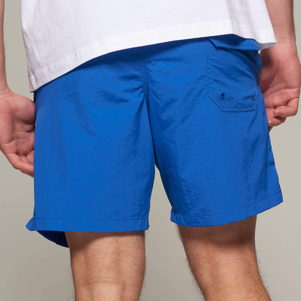 Fortmens model wearing North56 Sport Swim Shorts Cobalt Blue - back view