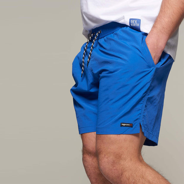 Fortmens model wearing North56 Sport Swim Shorts Cobalt Blue - side view
