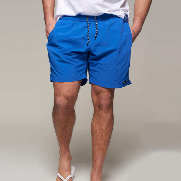 Fortmens model wearing North56 Sport Swim Shorts Cobalt Blue - front view