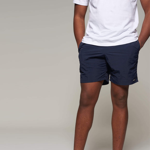 Fortmens model wearing a North56 Sport Swim Shorts - Navy Blue front view