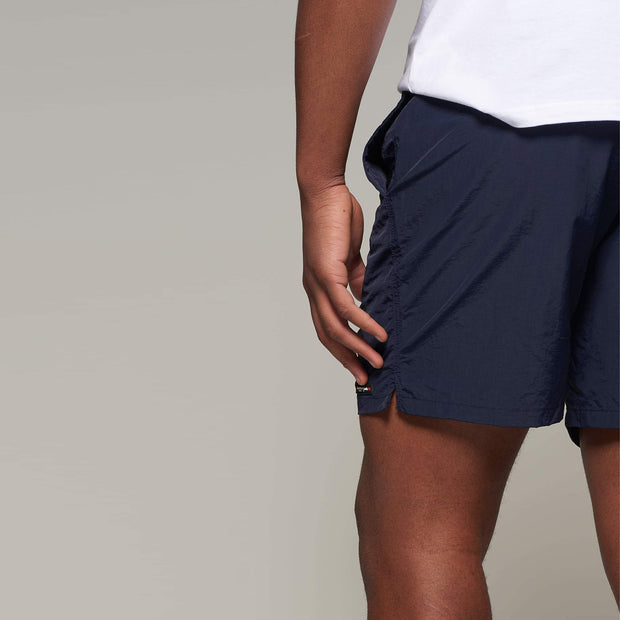 Fortmens model wearing a North56 Sport Swim Shorts - Navy Blue side view close up