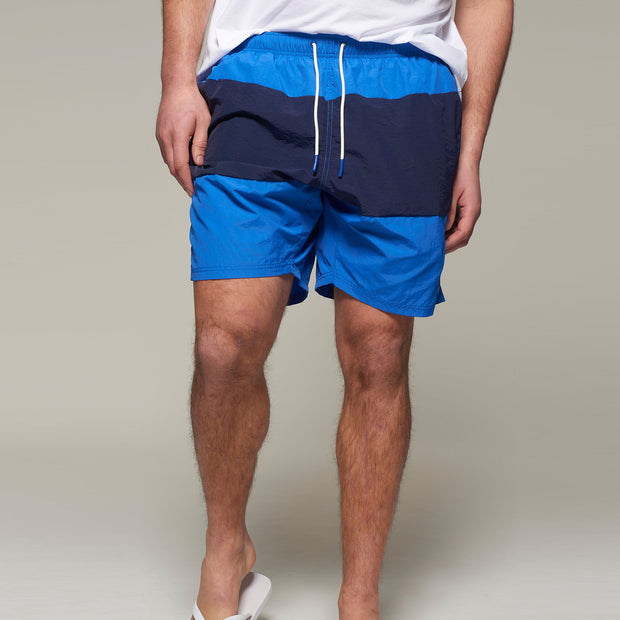 Fortmens model wearing a North56 Swim Shorts in Mid Blue back view