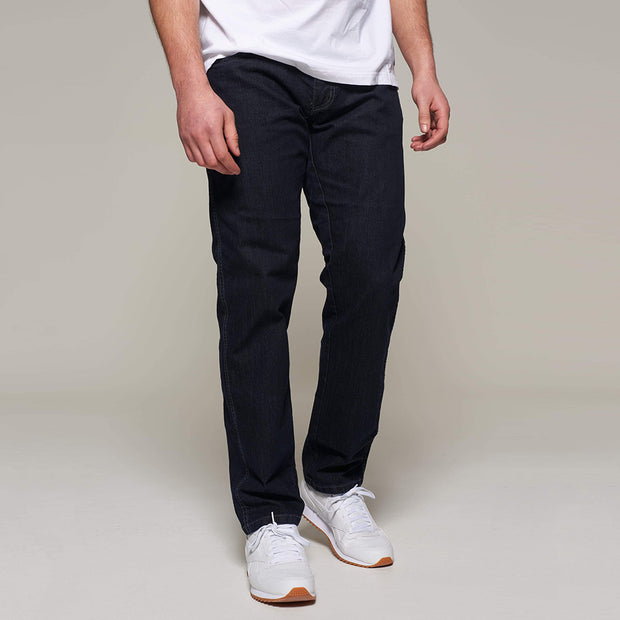 Fortmens model wearing a North 56°4 'Mick' Blue Stone Wash Jeans - side view