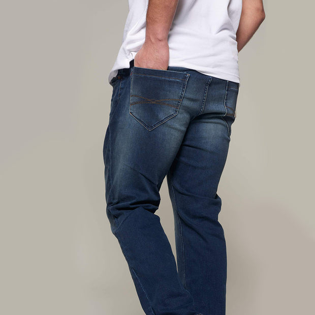 Fortmens model wearing Paddocks 'Ben' Dark Blue Denim Jeans - side view