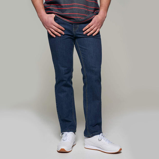 Fortmens model wearing a Paddocks 'Ranger' Dark Blue Denim Jeans - side view