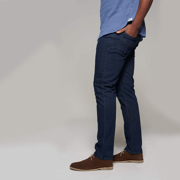 Fortmens model wearing Langley Dark Blue Jeans - side view