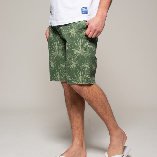 Fortmens model wearing Replika  Flower Printed Shorts in Jungle Green front view