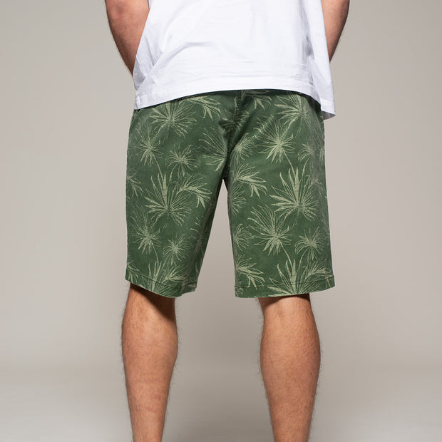 Fortmens model wearing Replika  Flower Printed Shorts in Jungle Green back view