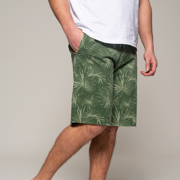 Fortmens model wearing Replika  Flower Printed Shorts in Jungle Green close up view