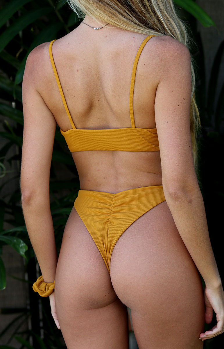 cheeky high waisted sport brief moderate coverage style bamboo emma bottom with matching sporty top from tai swim co