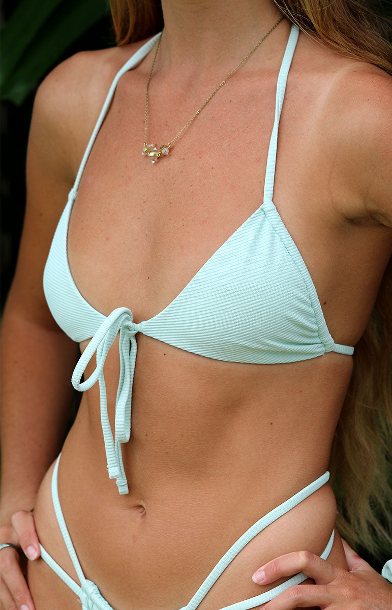 tai swim co ribbed joelle top and bottom close up with gold necklace and strappy matching eco fabric