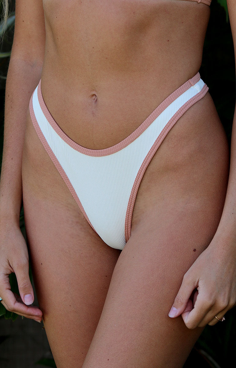 high rise cheeky white bikini bottoms with pink piping border sustainable eco swimwear