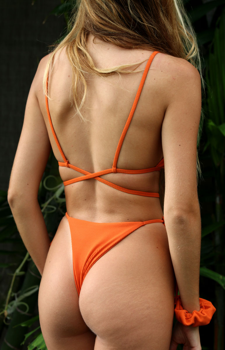 cross back bright orange bikini top from tai swim co