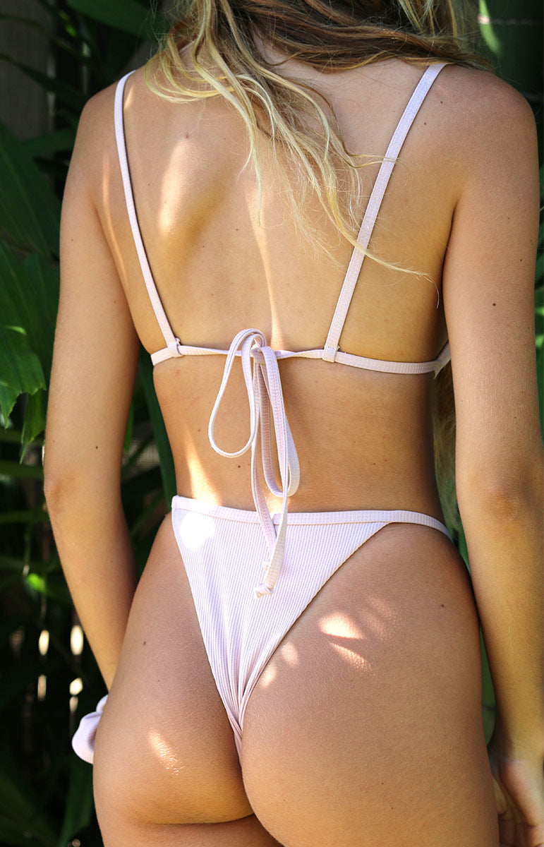 tai swim eli top on girl tied in the back with high waisted eli bottom