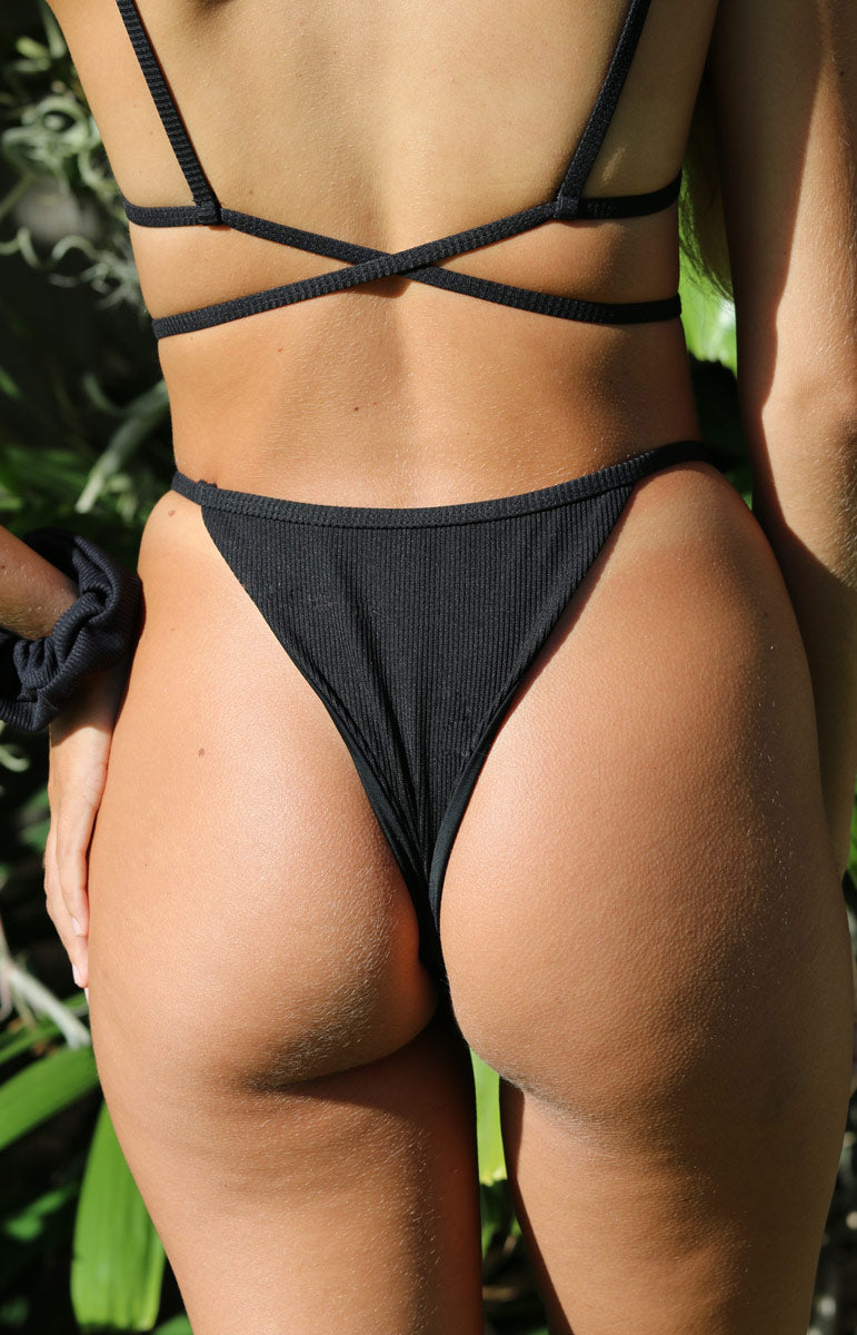 black cheeky ribbed bikini bottoms by tai swim co