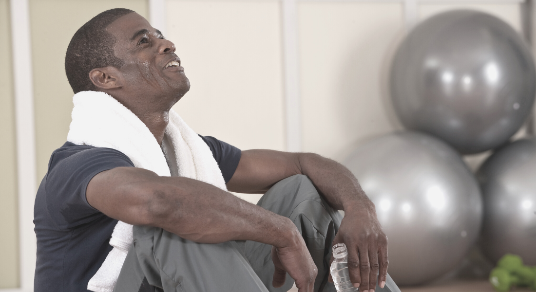 Man catching breath after working out at gym