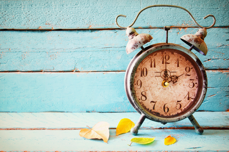 Fall Back Time Change Clock and Leaves