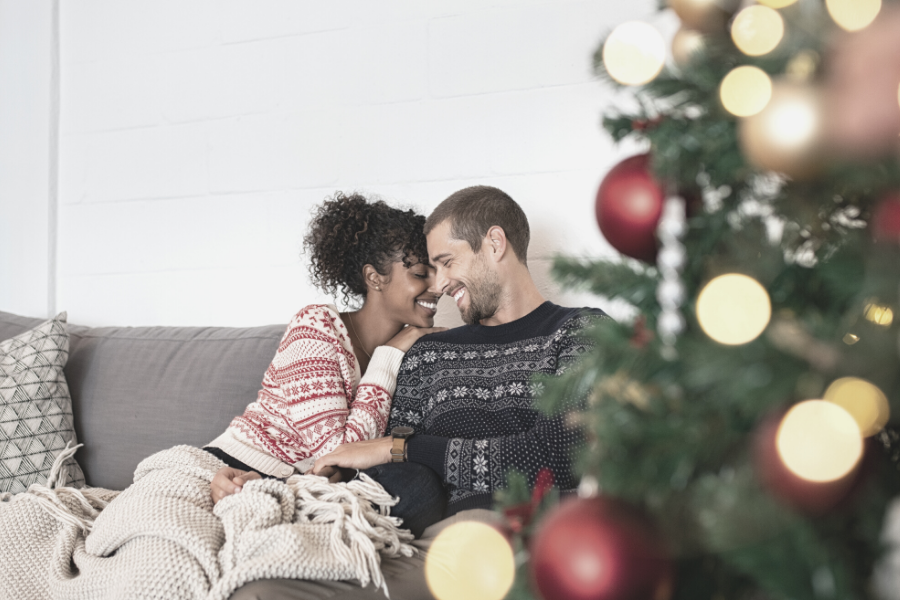 Happy couple at home during the holidays
