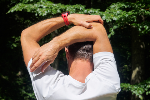Man Stretching Arm After Workoug
