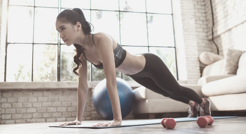 Woman working out in living room