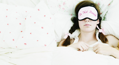 Woman sleeping wearing sleep mask