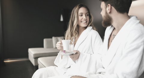 Couple at spa drinking coffee