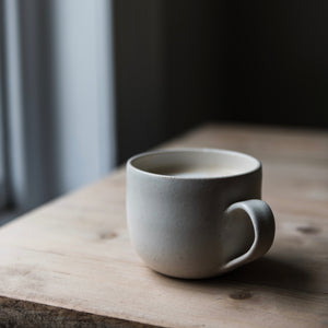 handmade simple white curved mug