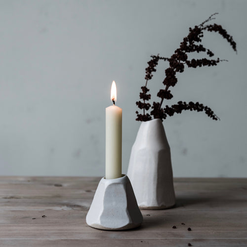 faceted white candle stick