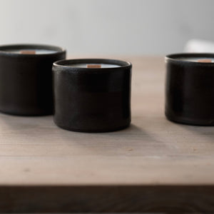 limited edition scented candle in handmade dark graphite ceramic tumbler