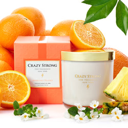 Crazy Strong 2-Wick Candle Sparkling Orange, juicy orange and pineapple slices and orange blossoms
