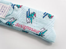 Load image into Gallery viewer, T Rex Skiing Socks Designosaur - ice blue 7-11