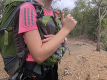 Load image into Gallery viewer, Close up of female hiker wearing Aarn pack with front pockets