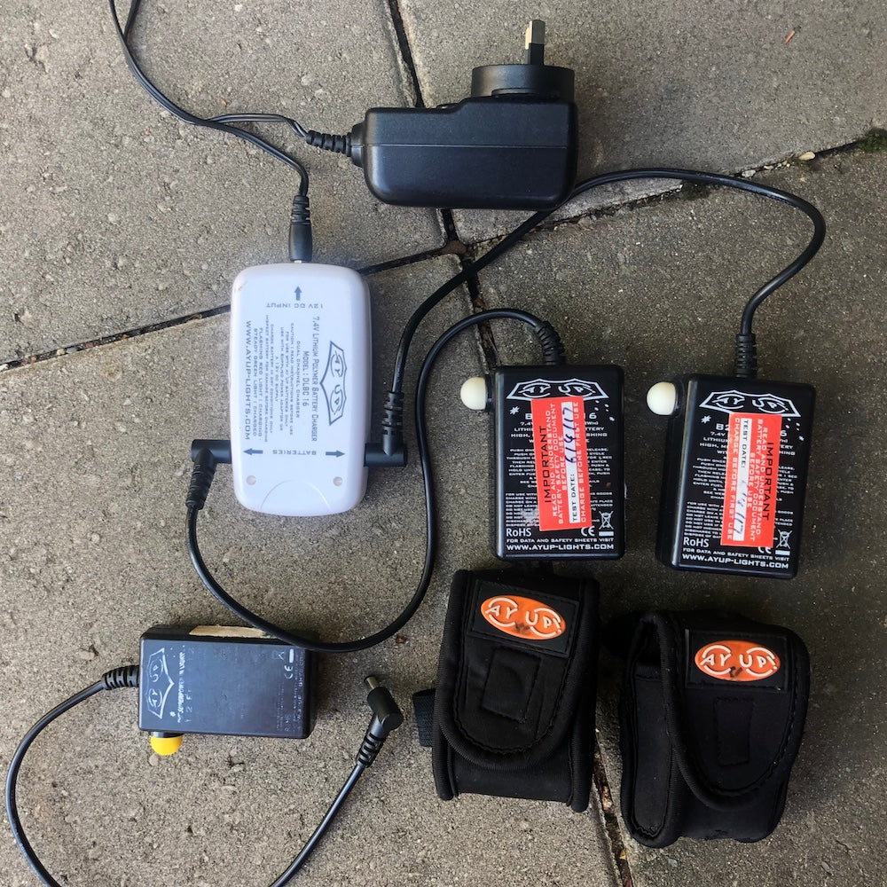 Two Ay-up batteries connected to charging device.