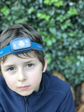 Load image into Gallery viewer, Child wearing Black Diamond head torch