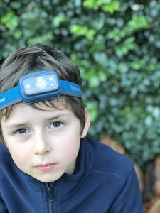 Child wearing Black Diamond head torch