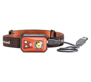 Black Diamond Revolt head torch with USB recharge cable connected