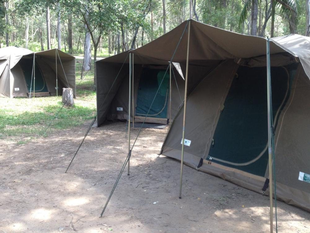 Three Canvas Safari Tents pitched at campsite