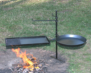 Cookstand stands next to campfire ready for use