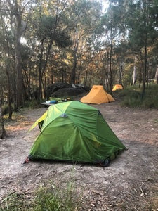 Wilderness Equipment Space 2 Tent pitched at campsite surrounded by trees