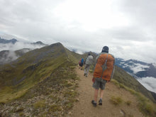 Load image into Gallery viewer, Young male wearing Aarn Natural Balance Pack hiking in New Zealand