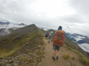 Young male wearing Aarn Natural Balance Pack hiking in New Zealand