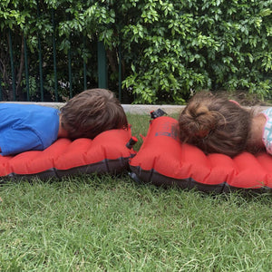 Two children laying on NEMO Cosmo Insulated Sleeping Mats