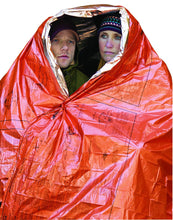 Load image into Gallery viewer, SOL Emergency Survival Blanket wrapped around 2 people