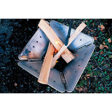 Load image into Gallery viewer, Snow Peak large fire pit top view with sticks ready to light