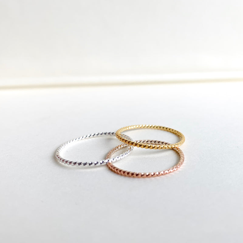 set of three rings in silver, rosegold, gold
