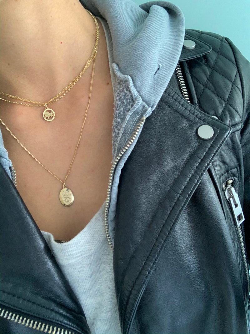 Girl wearing Love Charlie 10K Gold Chain Necklace with leather jacket and sweater